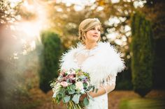 a stunning winter portrait of the bride at iscoyd park bride in fur stole shrug at sunset