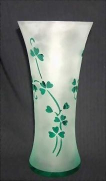 The lovely sprigs of clear green shamrocks show beautifully on this frosted glass vase.