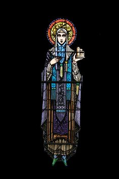 Saint Brigid: There are eleven Irish Saints depicted in the windows of Ballinrobe Church - these windows were designed and made by Harry Clarke in 1924.