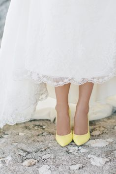 Follow the yellow pumps! Photography: Julia Kaptelova Photography - www.juliakaptelova.com/   Read More on SMP: http://www.stylemepretty.com/destination-weddings/2016/12/15/romantic-yellow-greek-wedding/