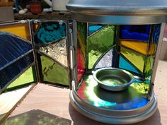 I got a few ROTERA tea light lanterns from IKEA, and popped out the glass panels they shipped with and replaced them with my own mini panels created from glass offcuts.