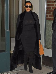 Back to black: Kim Kardashian sports an all-black outfit after stepping out in New York City without baby North on Friday night