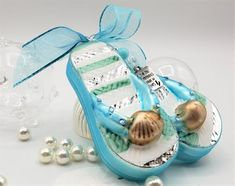 """Beach flip flop Christmas ornament, gorgeously coastal colored glass flip flops enhanced with a few rhinestones for bling and with a glass beaded charm dangle that says """" Some of the Best Memories Are Made in Flip Flops"""". Well of course they are😉. All one piece so they don't bang together and break.  We also add a fun ombre aqua organza bow that exactly matches too!"""