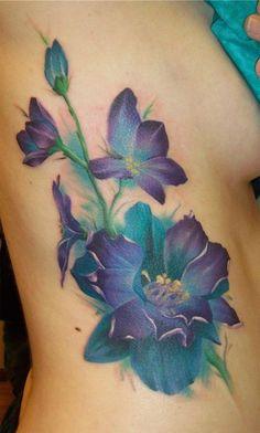 Rib flower tattoos #TattooModels #tattoo