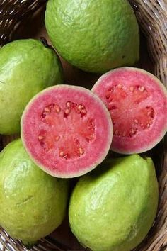 Guava is a sweet fruit with a tangy smell. It is an oval-shaped fruit with light green or yellow skin and contains small edible seeds. The high nutrient content gives guava their innumerable health benefits. The leaves of the guava tree Fresh Fruits And Vegetables, Fruit And Veg, Guava Fruit, Pink Guava, Pink Fruit, Eat Fruit, Guava Tree, Fruit Photography, Beautiful Fruits