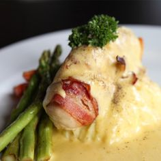 Mouthwatering, bacon wrapped chicken, covered in a creamy cheese sauce. �Serve with mashed potatoes and a colorful vegetable.. Bacon Wrapped Chicken With Creamy Cheese Sauce Recipe from Grandmothers Kitchen.