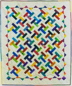Catherine Wheels Quilt Pattern by Lorraine Cocker at 2 Sew