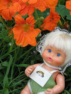 Sweet April Doll, I had this one in the green outfit, her legs were straight, not curved like the one in blue, so she could walk. Loved this doll so much.
