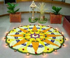 """Pookalams are traditional floral designs created on the largest festival in the Indian state of Kerala- Onam. During this festival period women indulge in cultural activities and make complicatedly designed flower mats called, """"Pookalam"""" in the front entrance of the house"""
