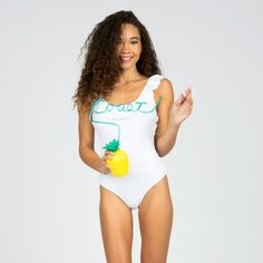 Be a showstopper at the pool in this fashion forward Lolli one piece. This one piece is trendy with its ruffle neck edge detail and low scoop back. The one piece was made for comfort but doesn't hinder style! Available in solid white and solid black.