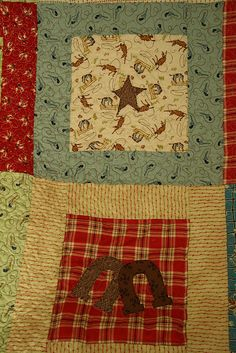 Cute vintage looking cowboy fabric quilt!  By roseylittlethings,