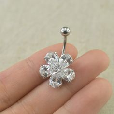 bellybutton rings crystal flower belly button jewelry navel... ($11) ❤ liked on Polyvore featuring jewelry, crystal jewelry, crystal jewellery, button jewelry, blossom jewelry and crystal stone jewelry