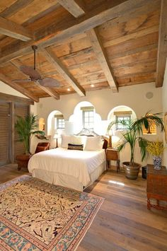 This bedroom was built using random width, reclaimed rustic barn oak flooring and sanded Douglas fir beams and planking in the ceiling. The beams measure 12x12 and 10x10 and the decking is a pattern of 1x12 and 1x6. The corbels and window lintels are also sanded Douglas fir. Products Used: Sanded Douglas Fir Plank, Sanded Douglas Fir Beams, Rustic Barn Oak Flooring