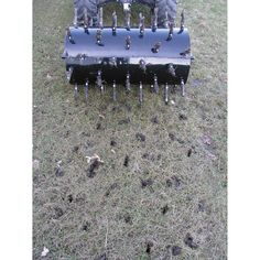 This plug aerator has fifty-four plugs that penetrate up to into the ground for full core aerating. drum holds up to 40 gallons of water for additional weight. Landscaping Equipment, Landscaping Tools, Lawn Equipment, Backyard Landscaping, Backyard Ideas, Small Garden Landscape, Lawn And Landscape, Landscape Design, Lawn And Garden