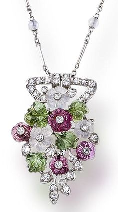 A diamond and gem-set pendant necklace  the central pendant of openwork design, set with carved moonstone and pink tourmaline flowers and carved green tourmaline leaves, accentuated by single-cut diamonds, suspended by a fancy-link chain detailed with eight moonstone beads; signed Tiffany & Co.; mounted in platinum