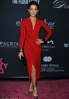 Kate Beckinsale a Donna Karan sleek wrap-around dress with silver and Jimmy Choo black sandals @ the Elyse Walker Presents The Pink Party 2013