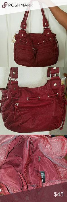 Brand New Leather handbag Beautiful brand new fashion handbag. No damages. Soft leather. Two side by side zip closures on top. One side has one zipper pocket and the other two slip pockets. Four front and one larger back zipper pockets. Red color with silver hardware. Bueno Bags