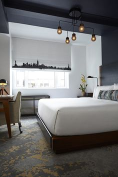 Design Detail – The headboards in this hotel suite are visually extended up the wall and across the ceiling