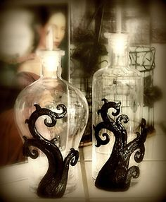 Creepy glass bottles for perfume or poison...or both, if you so please