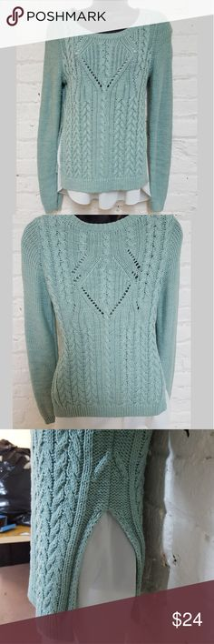 Mint green kint Sweater The front and back are shown in the first two pictures. This is a great sweater it's an amazing color. The sweater has a sheer top attached underneath the top cannot be separated from the sweater. Lightweight and loose-knit.  Size small. Great condition Sweaters Crew & Scoop Necks