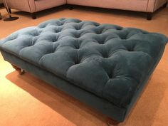 Deep button footstool 90 cm x 60 cm x 30 cm in Warwick Plush Velvet (mallard). We have used brown casters in the display but these may be changed if desired. The buttons are orange creating a playful twist. Bespoke Sofas, Cushion Filling, Mallard, Sofa Bed, Cribs, Ottoman, Plush, British
