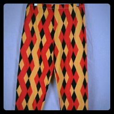 NWT Orange And Yellow Jester Desgn Leggings This is a brand new pair of leggings from Magid. They were only taken out of the package to take pictures! They are yellow, red and black jester like designs. The size chart for these are shown in the pictures! #nwt #new #leggings Magid Pants Leggings