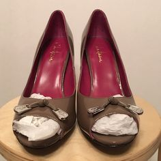 """Cole Haan Air Talia OT Pump 9.5 Greige Never worn. Part of the Nike Air collection. Heel height is 3.5"""". Gray-beige color in patent leather. Cole Haan Shoes Heels"""