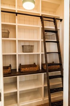 farmhouse style pantry with crates and ladder.