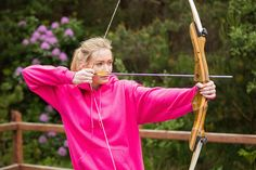 young woman practicing at an archery range