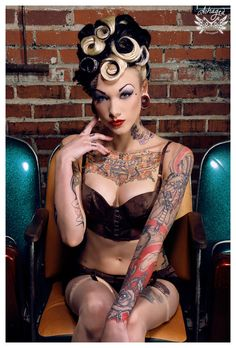 She is all over BAD ASS from the hair to the make up and TATTS!!!!!