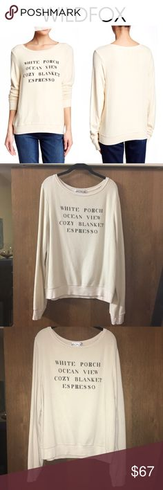 """Wildfox Hamptons House Baggy Beach Jumper Napkin Scoop neck, long sleeves and über comfy cozy! Gotta be a Wildfox BBJ! This soft and cozy jumper is an off white/ivory hue named """"napkin."""" The front graphic print reads """"White Porch, Ocean View, Coxy Blanket, Espresso"""" and has not faded. Approx. 26"""" length - 47% rayon, 47% polyester, 6% spandex -  EUC - GENTLY WORN AND LOVED - ONLY WORN A FEW TIMES - SIZE LARGE Wildfox Tops Sweatshirts & Hoodies"""