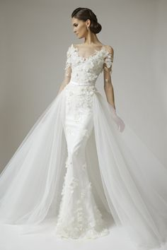 Wedding dresses with detachable tulle train allows the bride to have a lovely full wedding gown experience for her walk up the aisle, and the detachable train allows her to party the night away without a big train getting in the way.