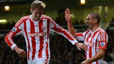 Jon #Walters (Stoke City FC)  Jon Walters (R) of Stoke City FC celebrates with Peter #Crouch (L) after scoring a goal during the English Premier League match against West Ham United FC