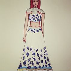 The beauty of tassels, florals & simplicity put together. Featuring white embellished blue florals. Inspired by Manish Malhorta. Featuring silver tassels, cut off shoulder blouse and blue florals prints.