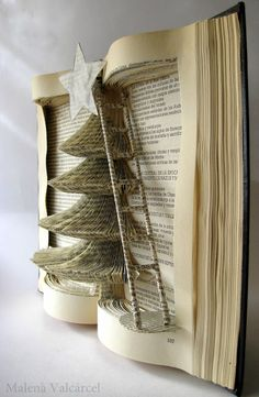 Christmas tree book art - this is gorgeous... but I could never bring myself to cut a book up!
