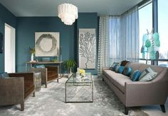 Paint color ideas that adhere to the practice of feng shui. Find 8 color schemes that bring balance into the living room.
