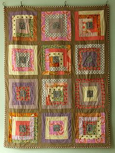 3-Log cabin quilt! not sure if there will be enought of one colour to put between each square