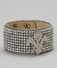 Shimmer and shine with this rhinestone-encrusted bracelet. Two sets of snaps help it go on and adjust easily.1.4'' W x 7.5'' to 9'' LLeatherImported