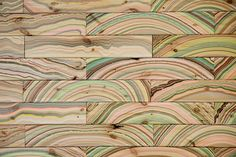 """Pernille Snedker Hansen has repurposed an old marbling technique giving wood a supernatural, organic, colorful and vibrant pattern. The applied decoration engages in a dialogue with the natural growth rings of the underlying wood. """