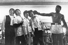 The Beatles meet Muhammad Ali.