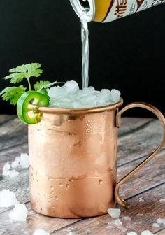 This Mexican Mule is fantastic! Had a delicious spicy kick from jalapeño and earthy herbal note from cilantro. Balanced out with orange and ginger liqueur and topped off with ginger beer and lime! Bar Drinks, Cocktail Drinks, Cocktail Recipes, Alcoholic Drinks, Beverages, Heathy Drinks, Vodka Cocktails, Cold Drinks, Beer Recipes