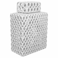 """Add an artful touch to your mantel or entryway console with this mosaic-inspired vase, perfect for displaying preserved flowers or a spray of willow branches.  Product: JarConstruction Material: PorcelainColor: WhiteDimensions: 11"""" H x 12"""" W"""