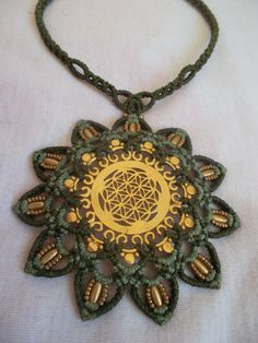 Mandala with The flower of life crimped in macrame by LunaticHands