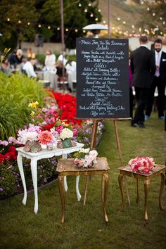 another chalkboard menu, made prettier with surrounding smaller tables & flowers
