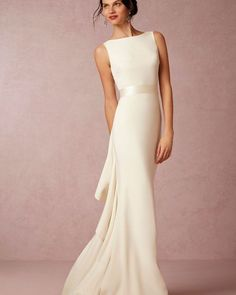 Design duo Mark Badgley and James Mischka met at fashion school in NYC. Building on an aesthetic of streamlined sophistication, luxurious detailing, and Old Hollywood glamour (a la Veronica Lake), look for interesting shapes and unique details from our collaboration with the team. Inspired by the elegance and breathtaking natural beauty of the French Riviera, this ivory crepe gown features a slim, sleeveless silhouette and a striking ruffled back that is guaranteed to be a ceremony…