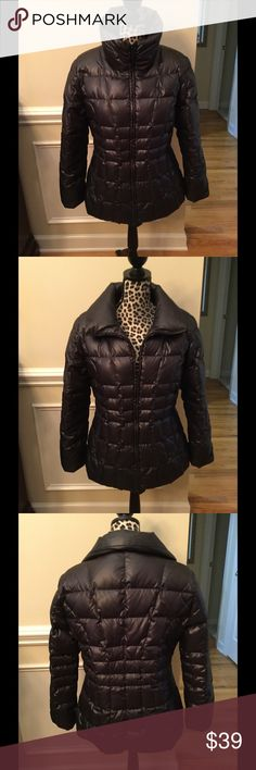 """Calvin Klein Down-Filled Puff Coat Size Large Like New Calvin Klein zip front puff coat filled with 80% Duck Down, 20% Waterfowl feathers. Outside is 100% Polyester. Slightly fitted at the waist. Collar can be turned up or worn open. Coat measures 28"""" from base of neck to bottom. Size Large but more like Medium/Large. From a smoke-free home. Calvin Klein Jackets & Coats Puffers"""