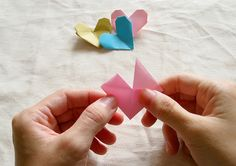 Origami Heart Tutorial I just tried it. This is pretty simple & there's good step by step pictures & instructions.