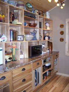 The other side of my new pantry with storage for small appliances, baking pans, and a few FUN things!