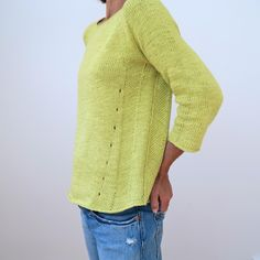 This pullover is quite simple in appearance, but comes with a few little design details that make it special. The A-line body shape makes it flattering on many body types. Intended to fit with ½ to 3 inches of ease at the bust.Knit entirely seamlessly from the top down, it is also quite easy to execute. The side details are formed by making basic increases and decreases.Thesample is knit in in a plant based yarn (Debbie Bliss Amalfi, which unfortunately has been discontinued and a…