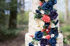 Inspirational photoshoot for a wild, colourful woodland wedding from photographer Ilaria Petrucci for british-bride.co.uk. Flowers, moss, champagne, flower covered umbrella, blue grooms suit, confetti, tree trunk cake stand Woodland Wedding Inspiration, Grooms, Confetti, Champagne, British, Suit, Photoshoot, Inspirational, Bride